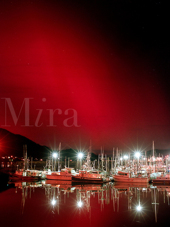 Intense red northern lights flare over Harris Harbor in Juneau, Alaska. ?â