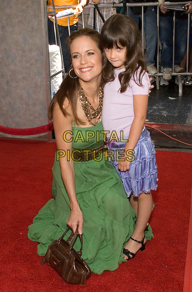 """KELLY PRESTON & DAUGHTER (ELLA BLEU TRAVOLTA).Walt Disney Pictures' World Premiere of """"Sky High"""" held at the El Capitan Theatre, Hollywood, California..July 24th, 2005  .Photo Credit: Zach Lipp/AdMedia.full length mother family green dress brown belt blue purple skirts necklace brown purse bag kneeling crouching.www.capitalpictures.com.sales@capitalpictures.com.© Capital Pictures."""