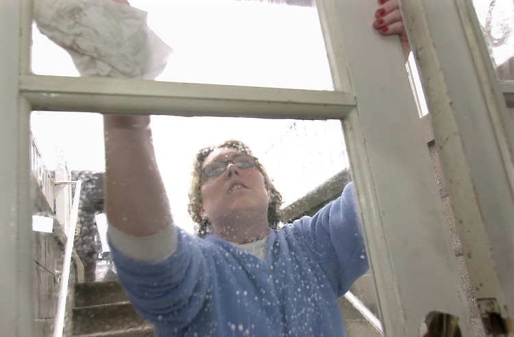 Senior Stacey Saunders cleans windows at the United Campus Ministry which was part of the Martin Luther King Jr. Volenteerism day.