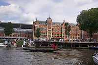 Of the many ways to ply the canals of Amsterdam, what could be better then in a Venetian canal boat with a lady in a red dress?