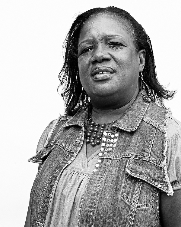 May 12, 2010. Chapel Hill, North Carolina.. Portraits of residents and concerned community members over the Greenbridge Development in Chapel Hill, NC.. Delaine Burnette Ingram is the owner of Delaine's House of Beauty, which is located 2 doors down on Graham Street from Greenbridge. She hopes the new development will bring customers to her store and that the communication between Northside resident and the new occupants of Grrenbridge will help heal the rift between the two groups.