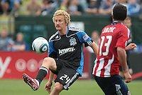Steven Lenhart (24) kicks the ball against Ante Jazic (13). Chivas USA defeated the San Jose Earthquakes 2-1 at Buck Shaw Stadium in Santa Clara, California on April 23rd, 2011.