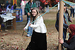 Embrey Inman runs around the Maypole during the Oxford High School Medieval Faire at Oxford High School in Oxford, Miss. on Wednesday, November 14, 2012.