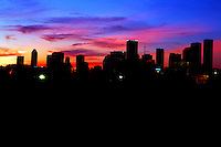 Stock photo of a colorful sunset behind the silhouette of the east downtown view of Houston skyline