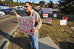 District 1 supervisor Mike Pickens holds a sign outside the old National Guard Armory in Oxford, Miss. on Tuesday, November 8, 2011. Mississippians go to the polls today for state and local elections, as well as referendums including the so-called Personhood Amendment.