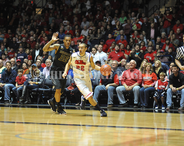 "Ole Miss' Marshall Henderson (22) vs. Missouri's Jabari Brown (32) at the C.M. ""Tad"" Smith Coliseum on Saturday, January 12, 2013. Ole Miss defeated #10 ranked Missouri 64-49."