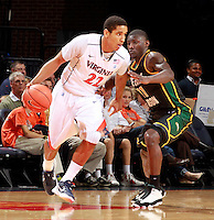 CHARLOTTESVILLE, VA- DECEMBER 6: Malcolm Brogdon #22 of the Virginia Cavaliers drives past Vertrail Vaughns #11 of the George Mason Patriots during the game on December 6, 2011 at the John Paul Jones Arena in Charlottesville, Virginia. Virginia defeated George Mason 68-48.(Photo by Andrew Shurtleff/Getty Images) *** Local Caption *** Vertrail Vaughns;Malcolm Brogdon