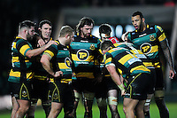 Northampton Saints forwards huddle together during a break in play. Aviva Premiership match, between Northampton Saints and Sale Sharks on December 23, 2016 at Franklin's Gardens in Northampton, England. Photo by: Patrick Khachfe / JMP