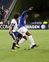 New England Revolution defender Kevin Alston (30) pursues Cruzeiro forward Eliandro (19).  Brazil's Cruzeiro beat the New England Revolution, 3-0 in a friendly match at Gillette Stadium on June 13, 2010