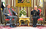 The Rev. Dr. Olav Fykse Tveit (left), the general secretary of the World Council of Churches, talks with Patriarch Louis Rafael Sako, president of the synod of the Chaldean Catholic Church, during the visit of an ecumenical delegation to Sako's office in Baghdad on January 21, 2017.