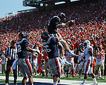 Ole Miss quarterback Bo Wallace (14) celebrates his touchdown catch with Ole Miss center Evan Swindall (56) vs. Auburn at Vaught-Hemingway Stadium in Oxford, Miss. on Saturday, October 13, 2012.