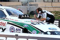 Jul. 19, 2013; Morrison, CO, USA: NHRA crew chief Jimmy Prock for funny car driver John Force during qualifying for the Mile High Nationals at Bandimere Speedway. Mandatory Credit: Mark J. Rebilas-