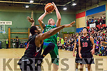 Star, Kieran Dinghy scores under the board for Garvey's Tralee warriors under a lot of pressure from Kubs Brian Edwards.