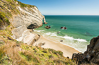 Small beach and archway at Cape Farewell near Collingwood, Nelson Region, South Island, New Zealand