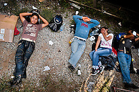 "Central American immigrants sleep under the stopped cargo train called 'La Bestia' (The Beast) on a train station in a border town of Arriaga, Mexico, 25 May 2010. Between 2010 and 2015, the US and Mexico have apprehended almost 1 million illegal immigrants from El Salvador, Honduras, and Guatemala. While the economic reasons remain the most frequent motivation for people from Central America to illegally immigrate to the US, thousands of Salvadorans, Guatemalans, and Hondurans, many of them minors, seek asylum in the US due to the thriving crime and gang-related violence in their region (known as the Northern Triangle). Taking an exhausting and risky journey, riding thousands of miles atop the cargo trains, facing a physical danger and extortion from the organized crime groups that control migrant routes, the ""undocumented"" still flee to the US, looking for their American dream."