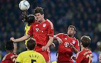 FUSSBALL   1. BUNDESLIGA   SAISON 2011/2012   30. SPIELTAG Borussia Dortmund - FC Bayern Muenchen            11.04.2012 Mario Gomez (2. v.l) und Jerome Boateng (re, beide FC Bayern Muenchen) gegen Neven Subotic (li, Borussia Dortmund)