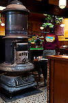 "The original ""Round Oak"" wood burning fire place in the center of McMenamin's Olympic Club Pub in Centralia, Washington State."