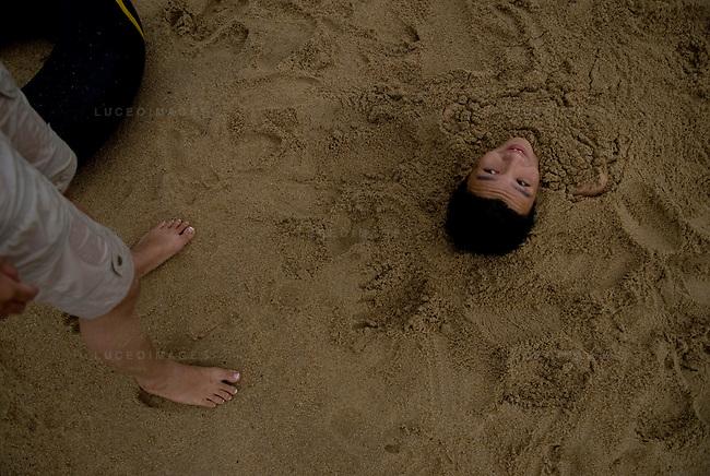 Vietnamese children play on the beach in Nha Trang, Vietnam.