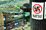 Katsu Sticker and Crossed-out Swastika on a lamppost. Manhattan, New York City