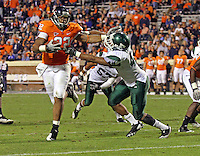 Oct 23, 2010; Charlottesville, VA, USA;  Virginia Cavaliers running back Keith Payne (22) runs in front of Eastern Michigan Eagles linebacker Marcus English (42) during the game at Scott Stadium.  Virginia won 48-21. Mandatory Credit: Andrew Shurtleff
