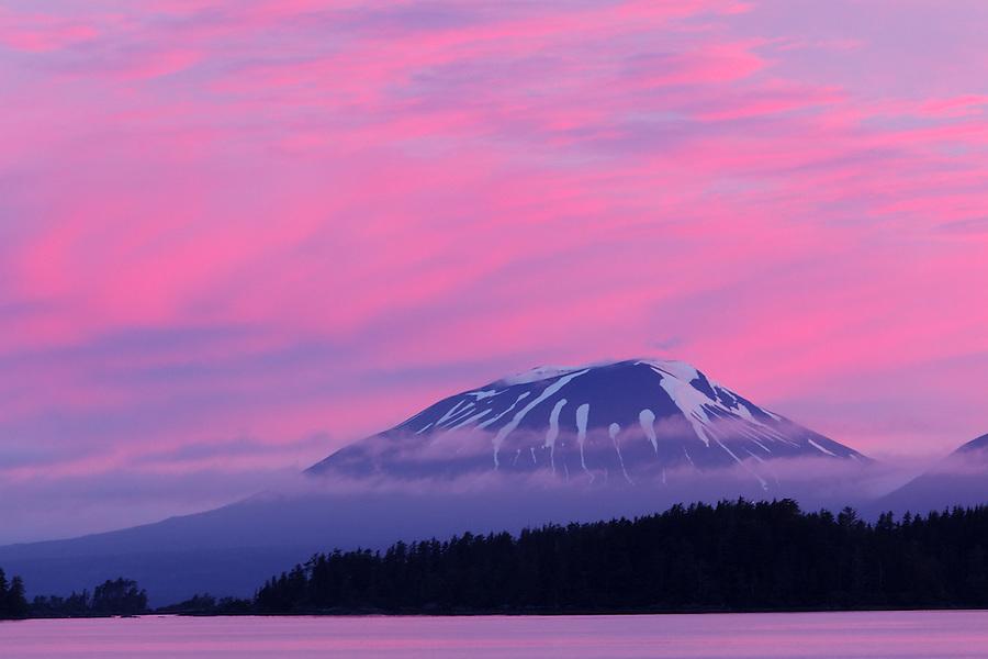 Pink sunset over volcanic Mount Edgecumbe, Sitka, Alaska, USA