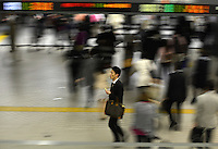 Businessmen at the West Exit during rush hour, Shinjuku, Tokyo.With up to 4 million passengers passing through it every day, Shinjuku station, tokyo, Japan is the busiest train station in the world. The station was used by an average of 3.64 million people per day.  That&rsquo;s 1.3 billion a year.  Or a fifth of humanity. Shinjuku has 36 platforms, and connects 12 different subway and railway lines.  Morning rush hour is pandemonium with all trains 200% full. <br /> <br /> Photo by Richard jones / sinopix