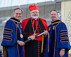 May 18, 2014; University of Notre Dame president Rev. John Jenkins, C.S.C., left, and Notre Dame Board of Trustees chairman Richard Notebaert, right, present an honorary degree to Cardinal Seán Patrick O&rsquo;Malley, O.F.M. Cap. at the 2014 Commencement ceremony in Notre Dame Stadium.<br /> <br /> Photo by Matt Cashore/University of Notre Dame