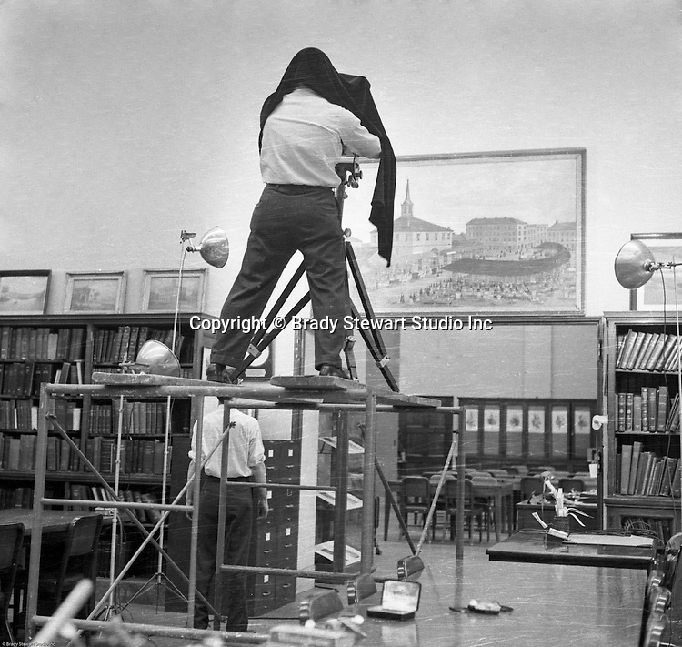 Pittsburgh PA:  Brady Stewart Jr., and Ross Catanza on location photographing an original painting of Pittsburgh's Market Square - 1956.