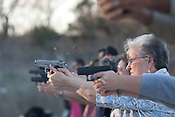 Carolyn Billington shoots a 9mm Smith & Wesson during a concealed handgun training class offered to teachers and staff of Clifton Independent School District in Clifton, Texas. Ms. Billington is a receptionist at Clifton Elementary School. February 7, 2013. CREDIT: Lance Rosenfield/Prime