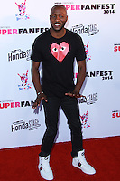 SANTA MONICA, CA, USA - OCTOBER 08: B.J. Britt arrives at the Vevo CERTIFIED SuperFanFest held at Barkar Hangar on October 8, 2014 in Santa Monica, California, United States. (Photo by David Acosta/Celebrity Monitor)