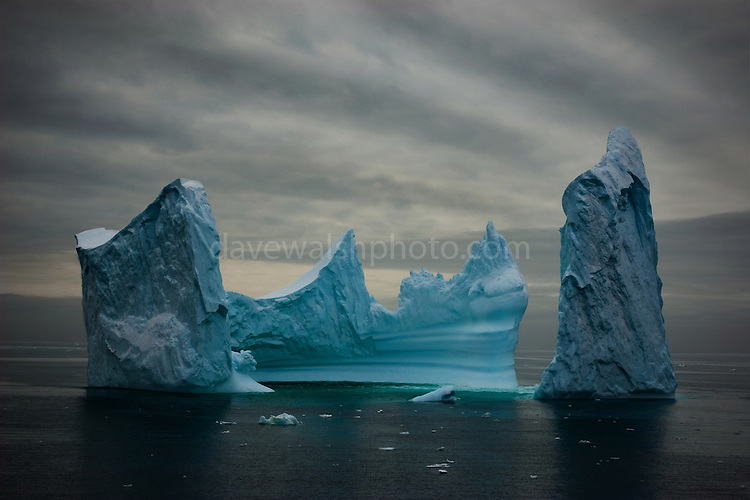 Limited edition C-Type Prints available - contact me for more details.<br /> <br /> This iceberg reminds of the painting by Bocklin called &quot;The Isle of the Dead&quot; - it's difficult to show scale with an image like this, but the iceberg was at least 100m tall in places, if not more. Photographed from on board the Greenpeace ship Esperanza, in the Southern Ocean, 8th February 2007. ....