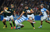 Eben Etzebeth takes on the Argentina defence. Rugby World Cup Bronze Final between South Africa and Argentina on October 30, 2015 at The Stadium, Queen Elizabeth Olympic Park in London, England. Photo by: Patrick Khachfe / Onside Images