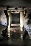 A dark wet underground hallway in decay