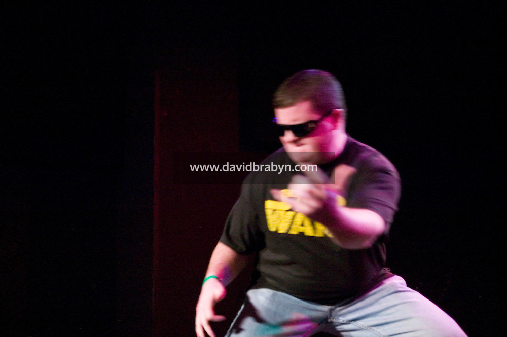 Performers appear on stage in an Air Guitar competition in New York City, USA, 2 March 2006.