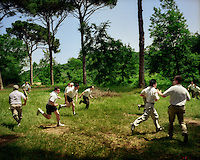 Legionaries of Christ priests play sport in a suburb out of their community in Rome. The Legion of Christ is a conservative Roman Catholic congregation whose members take vows of chastity, obedience and poverty.