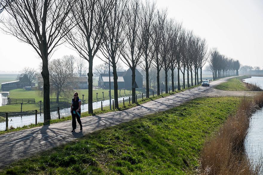 Nederland, Alkmaar, 17 maart 2015<br /> De Rijp, zeer mooi dorpje behorend tot de gemeente Alkmaar. Westdijk, afwateringsboezem van de polder.<br /> Foto: (c) Michiel Wijnbergh