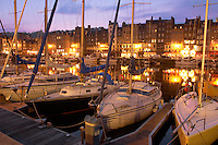 Nigh harbour scene with yaughts and harbour restaurants. Honfleur, Normandy, France.