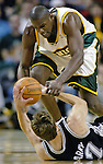 Seattle SuperSonics Jerome James and San Antonio Spurs Brent Barry battle for the ball in the first period of their  Western Conference Semifinals Game 4 in Seattle, Washington on Sunday, 15 May 2005.  Jim Bryant Photo. &copy;2010. All Rights Reserved.