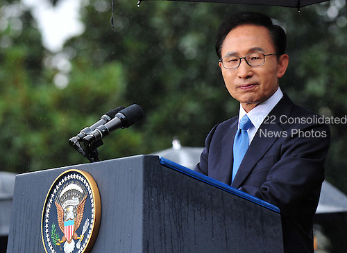 President Lee Myung-bak of South Korea delivers remarks with United States President Barack Obama (not seen) during an arrival ceremony on the South Lawn of the White House in Washington, D.C. on Thursday, October 13, 2011.  .Credit: Kevin Dietsch / Pool via CNP