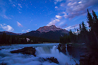 Athabasca Falls in Jasper National Park, Alberta, Canada, taken by night with moonlight in the sky and faintly on the mountains. Taken July 27, 2012 with the Canon 7D and 10-22mm lens for 30s exposure at f/4 and ISO 1250. Mount Kerkeslin is the the distance.