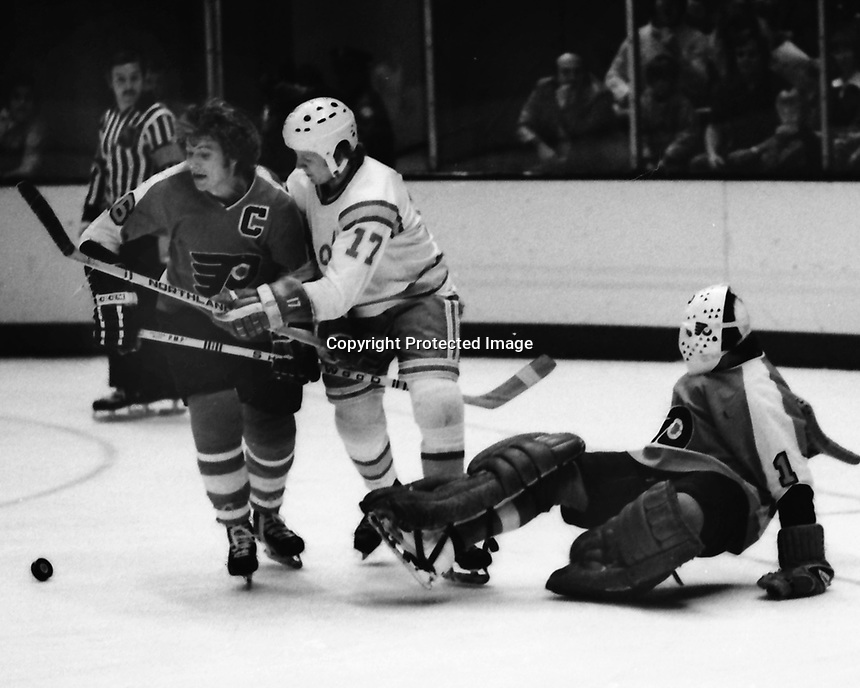 Seals vs Philadelphia Flyers 1975. Philly Andre Dupont, and goalie Bernie Parent, Seals #!7 John Stewart. (photo/Ron Riesterer)