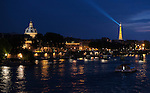 View to the southwest over the Seine from the Pont Neuf in late evening, showing the Institut de France and the Eiffel Tower.