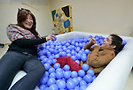 Micaela Torrero (right) relaxes as she talks with Margot Birriel in a multi-sensory room at the Instituto de Buena Voluntad (the Good Will Institute) in Montevideo, Uruguay. Sponsored by the Methodist Church of Uruguay, the institute works with youth and adults with disabilities. Birriel is a technical advisor to the institute, which receives financial support from United Methodist Women. Outside the room, Torrero spends much of her time in a wheelchair.