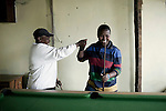 CAPE TOWN, SOUTH AFRICA - OCTOBER 19: Lesbians Zikona Moloyinyan (r) and Phato Mkhosana plays pool in a gay only bar on October 19, 2011 in Khayelitsha outside Cape Town, South Africa. Cape Town is a city known for tolerating gays and lesbians except in the townships where they get harassed and often attacked. Some women have been raped in so called corrective rape, where men rapes them to make them women again. They can't show their love freely on the streets in the townships so they usually have to meet in houses and this bar.  (Photo by Per-Anders Pettersson)