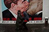 Berlin, Germany<br /> November 9, 2009<br /> <br /> Crowds of tourists visit the east side gallery, on the 20th anniversary of the Fall of the Berlin wall. It has become a popular tourist attraction.