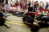 Young hongkongers are performing a scene to symbolize the represion of the democratic movement of Tiananmen in 1989 before the vigil in memory of the victims. Hong kong, june 4 2010.