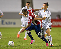 CARSON, CA - July 7, 2012: Chivas USA forward Jose Correa (27) and Vancouver Whitecaps midfielder Alain Rochat (4) during the Chivas USA vs Vancouver Whitecaps FC match at the Home Depot Center in Carson, California. Final score Vancouver Whitecaps FC 0, Chivas USA 0.