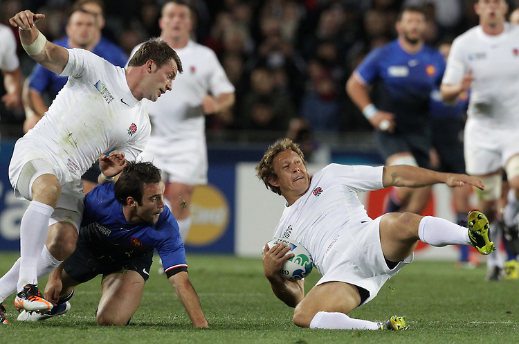 England's Jonny Wilkinson lands after jumping for the ball whilst playing against France during quarter-final 2 match of the Rugby World Cup 2011, Eden Park, Auckland, New Zealand, Saturday, October 08, 2011.  Credit:SNPA / David Rowland