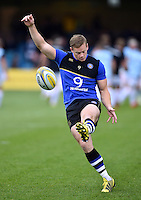 Chris Cook of Bath Rugby puts boot to ball during the pre-match warm-up. Aviva Premiership match, between Bath Rugby and Exeter Chiefs on October 17, 2015 at the Recreation Ground in Bath, England. Photo by: Patrick Khachfe / Onside Images