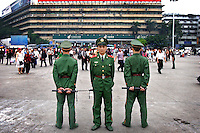 Chinese military keep watch on the public in Guangzhou's main Square.